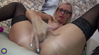 Mature amateur blonde secretary Dirty Tina masturbates thither glasses unaffected by
