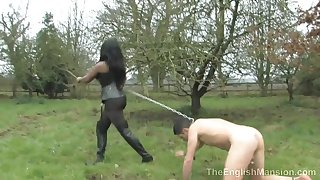 Black Mistress And Her Poor Naked Be conducive to Slave